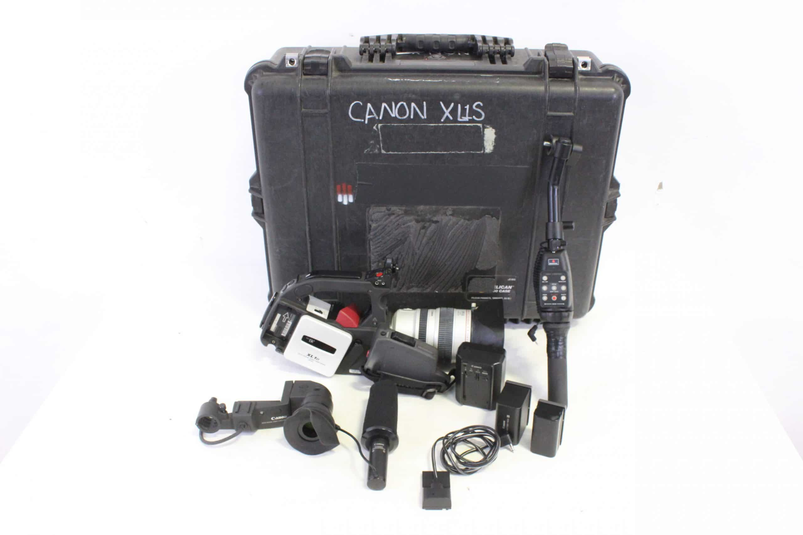 canon-xl1s-3ccd-digital-camcorder-w-canon-shotgun-microphone-canon-16x-zoom-xl-55-80mm-is-ii-video-lens-manfrotto-zoom-focus-controller-in-pelican-case main